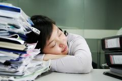 Asian woman have a break. Asian women have a break in office Royalty Free Stock Photography