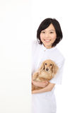 Asian women have a dachshund and a empty board Royalty Free Stock Photos
