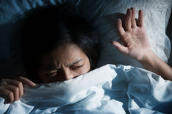 Asian Women Having Trouble About Getting Up Early In The Morning Royalty Free Stock Images