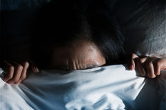 Asian women having trouble about getting up early in the morning. Nightmare concept. Dark tone. Asian woman having trouble about getting up early in the morning Stock Photos