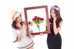 Asian women holding the frame with red flower Royalty Free Stock Photo