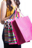 Asian women on holding a lot of shopping bag Stock Photo