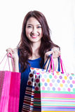 Asian women on holding a lot of shopping bag Stock Images