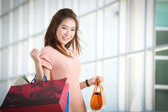 Asian women on holding a lot of shopping bag Royalty Free Stock Images