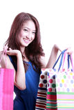 Asian women on holding a lot of shopping bag Royalty Free Stock Photo