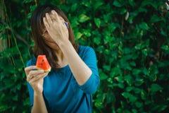 Asian Women Holding Slice Of Watermelon royalty free stock photos