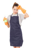 Asian Women Housewife Tired With Cleaning Cloth And Spray Bottle in protective. Royalty Free Stock Photos