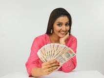 Asian woman with indian money Stock Photos