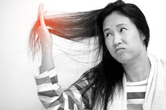 Asian women are looking damaged hair Royalty Free Stock Photos