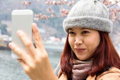 Asian women are looking at her cellphone Stock Photo