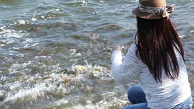 Asian women make merit by feeding fish stock video footage