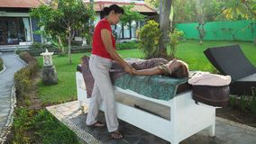 Woman doing massage to girl in asia. Bali,Indonesia. Royalty Free Stock Image