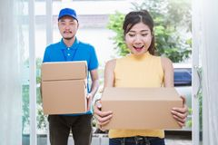 Asian woman and asian man carry boxes. Asian women and asian men carry boxes. Start up small business entrepreneur SME or freelance asian women and men working Stock Images