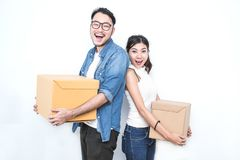 SME or freelance asian woman and man working with box. Asian women and asian men carry boxes. Start up small business entrepreneur SME or freelance asian women Royalty Free Stock Photography