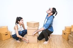 SME or freelance asian woman and man working with box Royalty Free Stock Photo
