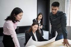 Asian women and men engineers discussing business project and sm. Iling in office,soft focus and blurry Stock Image