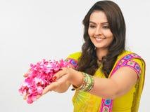 Asian women offering flowers. Asian women of indian origin offering flowers Royalty Free Stock Image