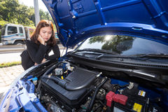 Asian women opened the hood and looking at broken down car Stock Images