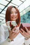 Asian women opening a gift box Royalty Free Stock Images