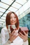 Asian women opens a gift box Stock Photo