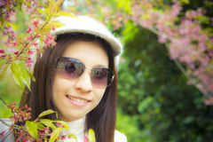Asian women with pink cherry flower Stock Photo