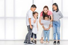 Teacher teaching kids in acting class. royalty free stock images