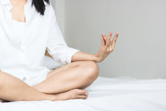 Asian women play yoga. On bed in morning Stock Images