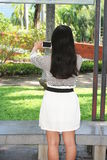 Asian women playing phone in the park. Asian woman playing phone in the park. using the phone with emotions Stock Photo
