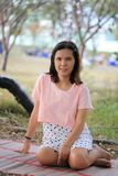 Asian women are pregnant for about twelve weeks. Asian woman are pregnant for about twelve weeks to enjoy sitting relax and happy in the garden Royalty Free Stock Images