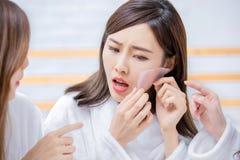 Asian women with oily skin stock photos