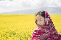 Asian women in rape flower Stock Photography