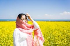Asian women in rape flower Royalty Free Stock Photography