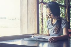 Asian women read book to learning on desk royalty free stock photo