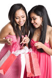 Asian women receiving valentine gifts. Two beautiful asian women receiving valentine gifts Royalty Free Stock Photos