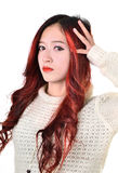 Asian women red long hair in modern fashion Royalty Free Stock Photo