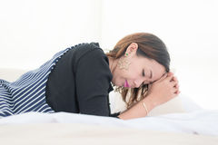 Asian women relax and laying on the bed Stock Photo