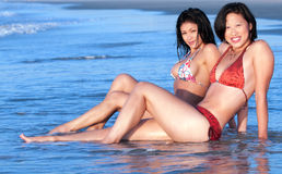 Asian Women relaxing in ocean Royalty Free Stock Photography