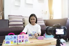Asian women review playing with toys at home. With recording making video royalty free stock photography