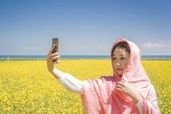 Asian women Selfie in flower Stock Photo