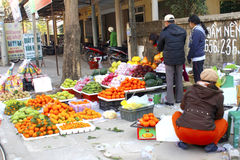 Asian women selling fruit in the market Royalty Free Stock Photo