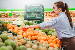 Asian women shopping Healthy food vegetables and fruits in supermarket stock photo