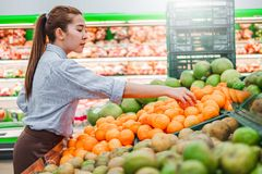 Asian women shopping Healthy food vegetables and fruits in supermarket royalty free stock photos