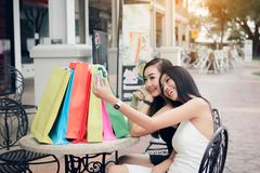 Asian women shopping and sitting selfie outside shop retail mall.  royalty free stock photos
