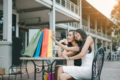 Asian women shopping and sitting selfie outside shop retail mall.  royalty free stock photo