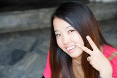 Asian women showing two fingers Stock Photos