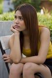 Asian women are sitting sadly. Royalty Free Stock Photos