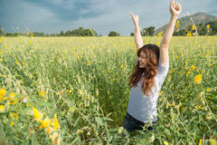 Asian women with slightly curly is raising arms to the sky in y royalty free stock photography