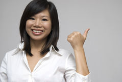 Asian women smiling and giving thumbs up Royalty Free Stock Photo