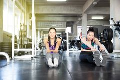 Asian women are stretching before exercise. Woman stretching out stock photography