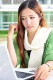 Asian women student with computer laptop Stock Photo